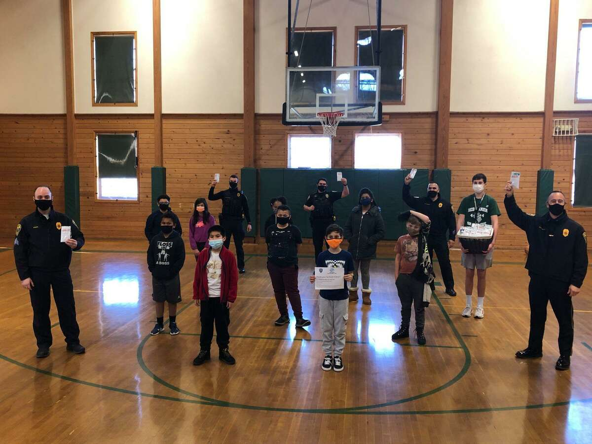 The Wakeman Boys & Girls Club donated 120 'survival kits' to Fairfield Police this weekend and shot hoops with some of the officers.