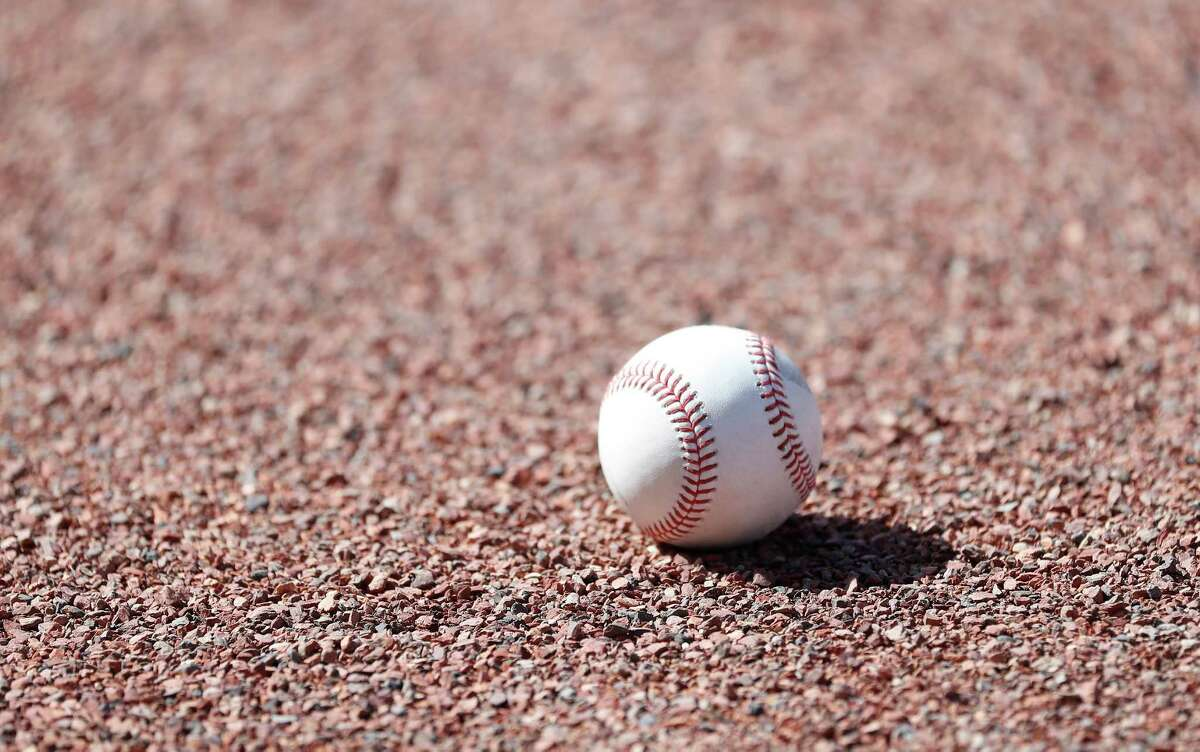 A baseball on the warning track during spring training workouts for the Astros at Ballpark of the Palm Beaches in West Palm Beach, Florida, Thursday, February 25, 2021.