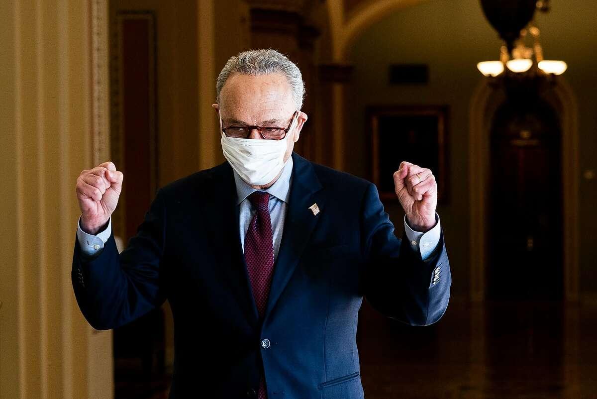 Senate Majority Leader Chuck Schumer, D-N.Y., celebrates after the Senate's passage of President Biden's $1.9 trillion stimulus bill.
