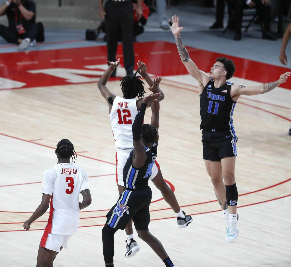 Houston Cougars guard Tramon Mark (12) shoots his game-winning three-pointer at the buzzer as Cougars beat Memphis Tigers 64-76 during the second half of an NCAA Men's basketball game at the Fertitta Center, Sunday, March 7, 2021, in Houston.