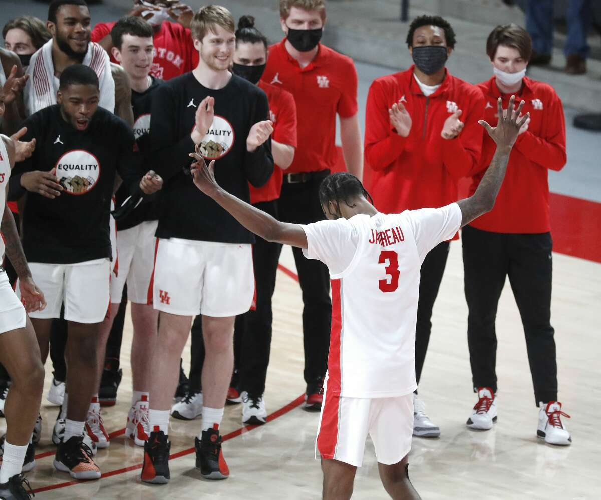 Houston Cougars guard DeJon Jarreau (3) drops the microphone after he addressed the fans after the Cougars 64-67 win over Memphis Tigers an NCAA Men's basketball game at the Fertitta Center, Sunday, March 7, 2021, in Houston.