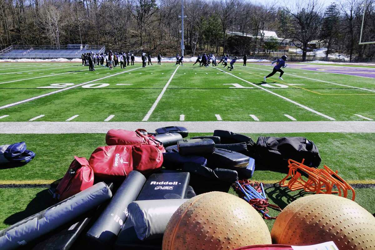 Troy High School football players take part in practice on Sunday, March 7, 2021, in Troy, N.Y. (Paul Buckowski/Times Union)