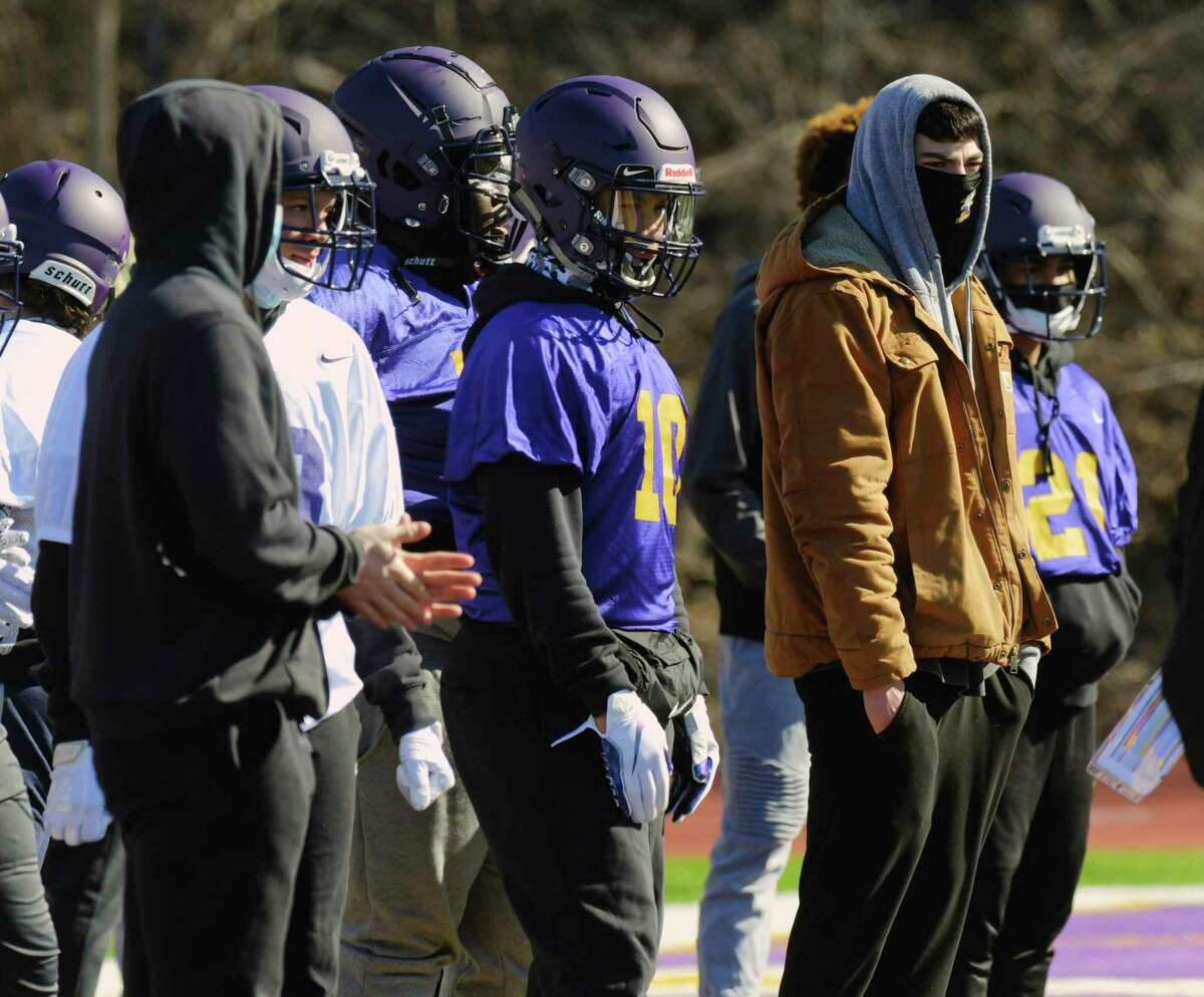 Troy High School football quarterback, Alex Wolfe, far right, watches his teammates practice on Sunday, March 7, 2021, in Troy, N.Y. Wolfe is playing basketball for Troy and can attend practice but can not take part in the drills while basketball season is still on. (Paul Buckowski/Times Union)
