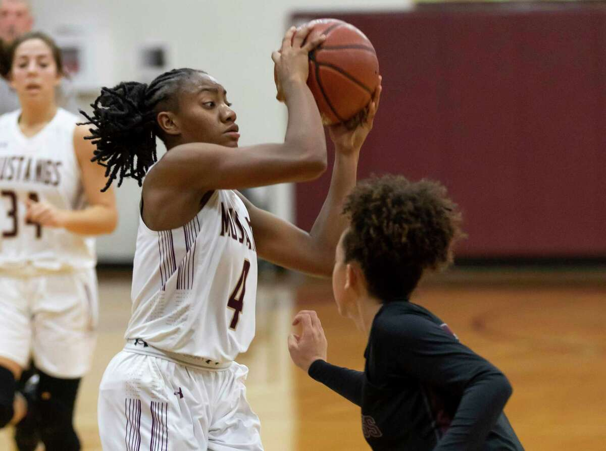 Magnolia West point guard Kamari Portalis (4) was named the District 19-5A Defensive MVP.