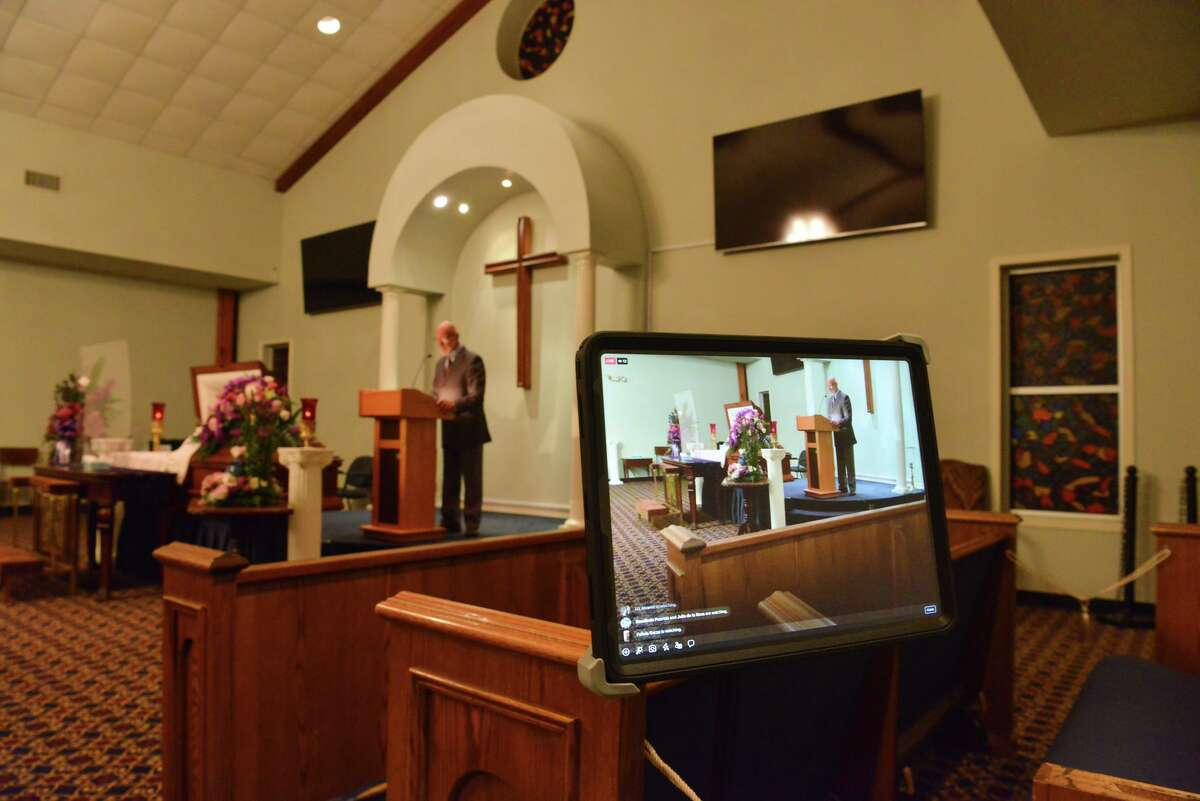 The service for Maria Concepcion Garcia was livestreamed from the chapel at Treviño Funeral Home, an accommodation added since the coronavirus pandemic. Funeral homes have had to limit the number of guests, require face masks and use physical distancing to avoid spreading the virus.