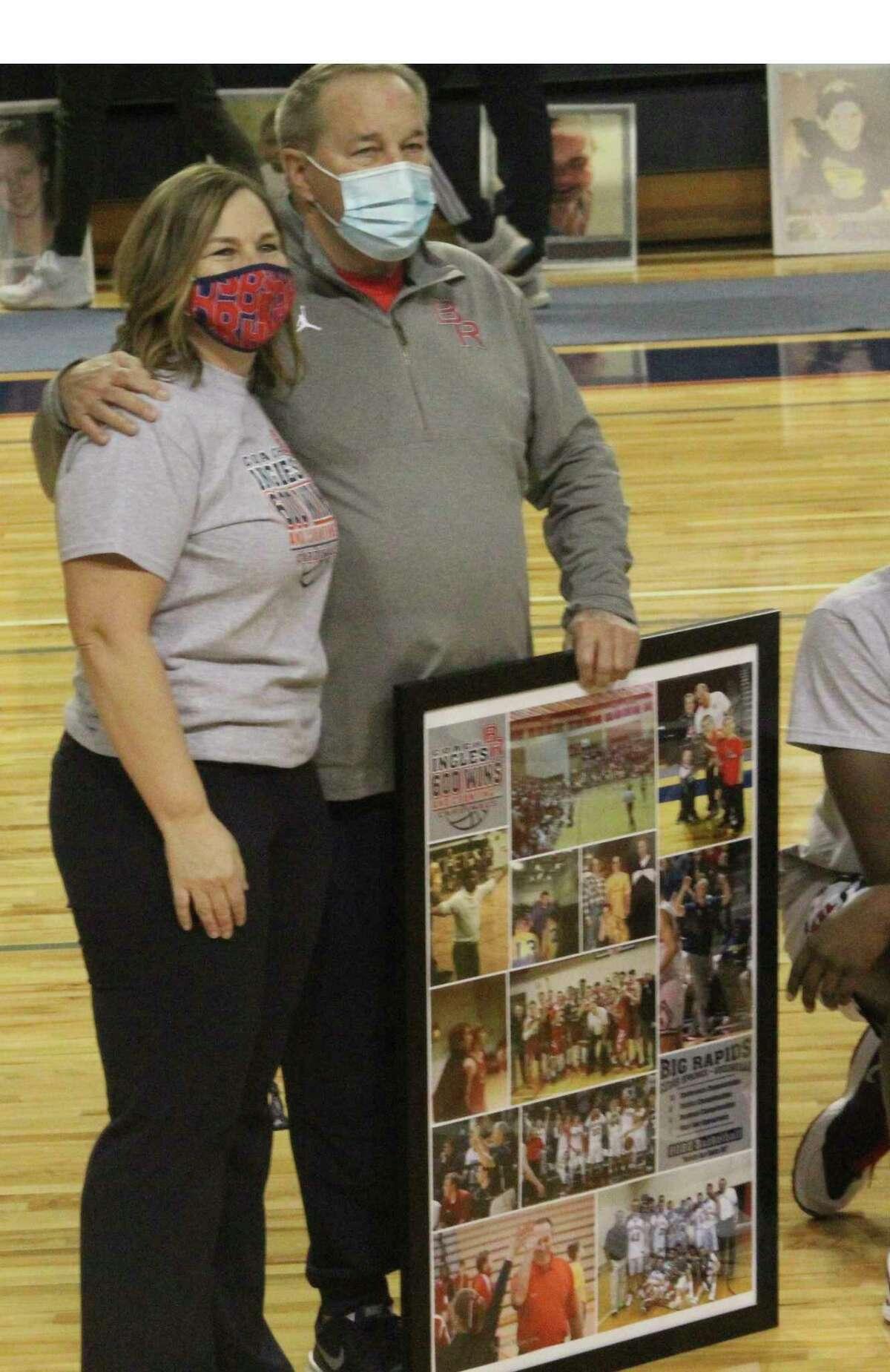 Big Rapids' athletic director Dawn Thompson (left) congratulates Kent Ingles on passing the 600-win mark. (Pioneer photo/John Raffel)