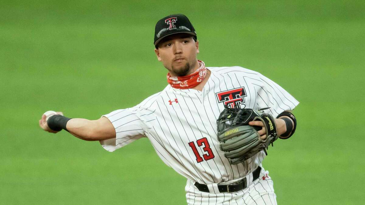 Texas Tech shortstop Cal Conley (13) throws during warmups during an NCAA baseball game against Mississippi State on Monday, Feb. 22, 2021, in Arlington, Texas. Mississippi State won 11-5. (AP Photo/Brandon Wade)