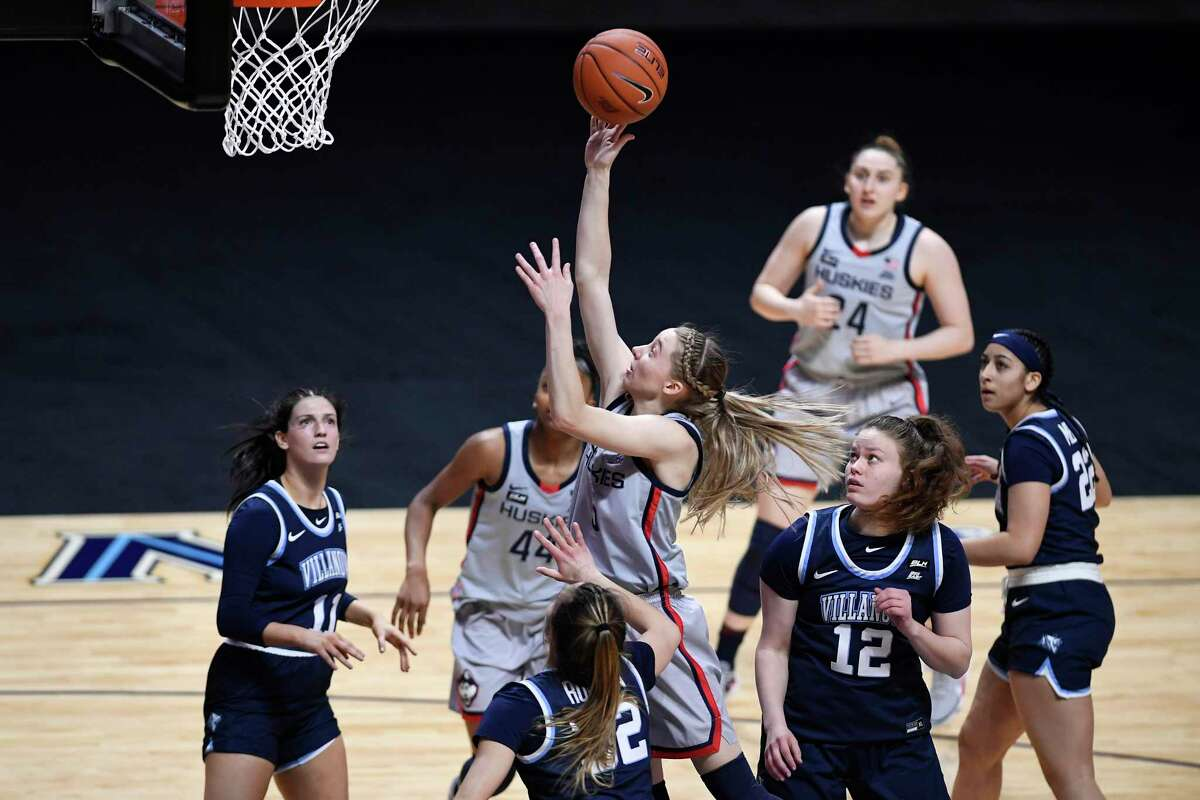 UConn's Paige Bueckers, center, shoots as Villanova's Bella Runyan (32) defends during the first half of the Big East tournament semifinals on Sunday at Mohegan Sun Arena in Uncasville.