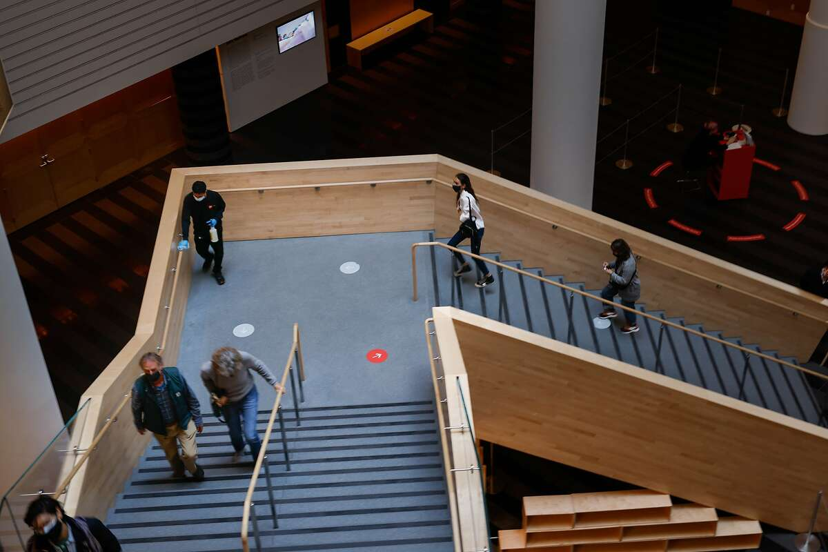 Guests mount the grand staircase at SFMOMA in San Francisco as it reopens to the public after nearly a year of closure due to the pandemic restrictions.