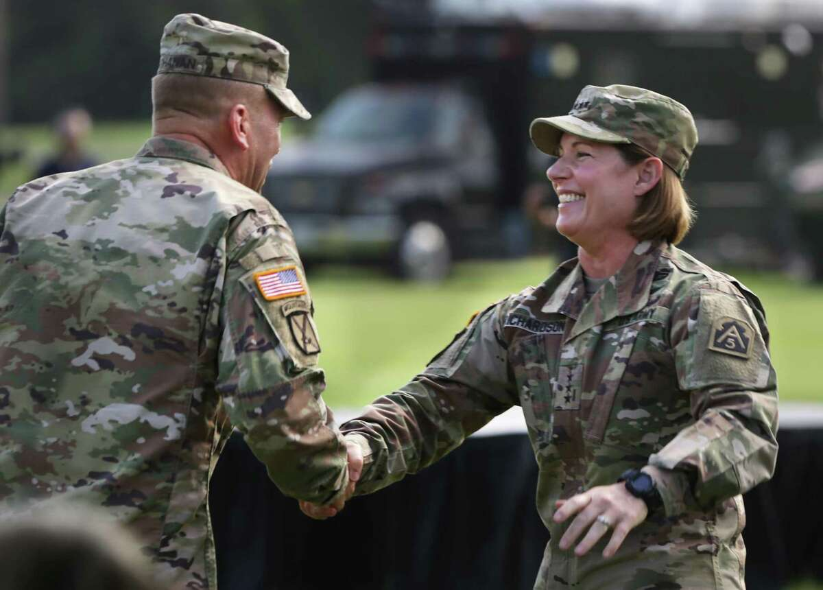 Lt. Gen. Jeffrey Buchanan, left, greets Lt. Gen. Laura Richardson who is taking command of U.S. Army North during the Change of Command at Fort Sam Houston, Monday, July 8, 2019.
