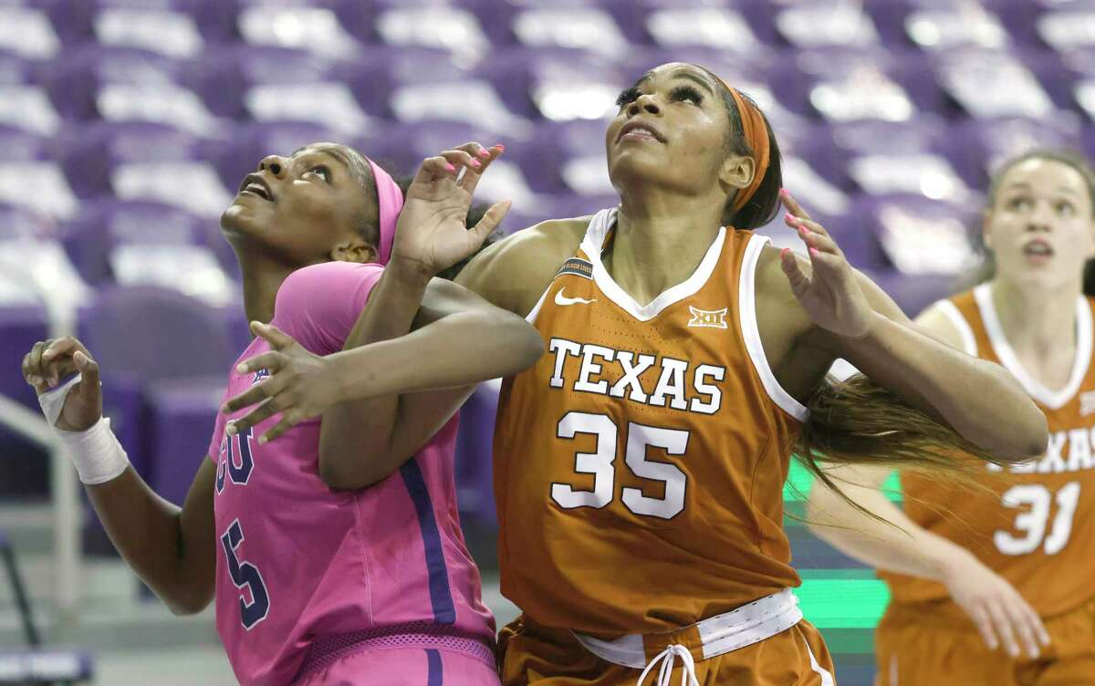 Texas forward Charli Collier (35) battles TCU forward Yummy Morris (5) for position during the first half of an NCAA college basketball game, Sunday, March 7, 2021, in Fort Worth, Texas. (AP Photo/Ron Jenkins)