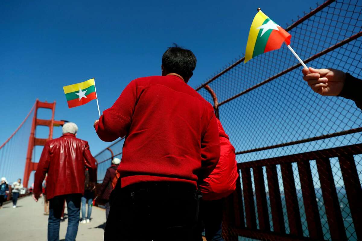A group walks across the Golden Gate Bridge in solidarity with the people of Myanmar.