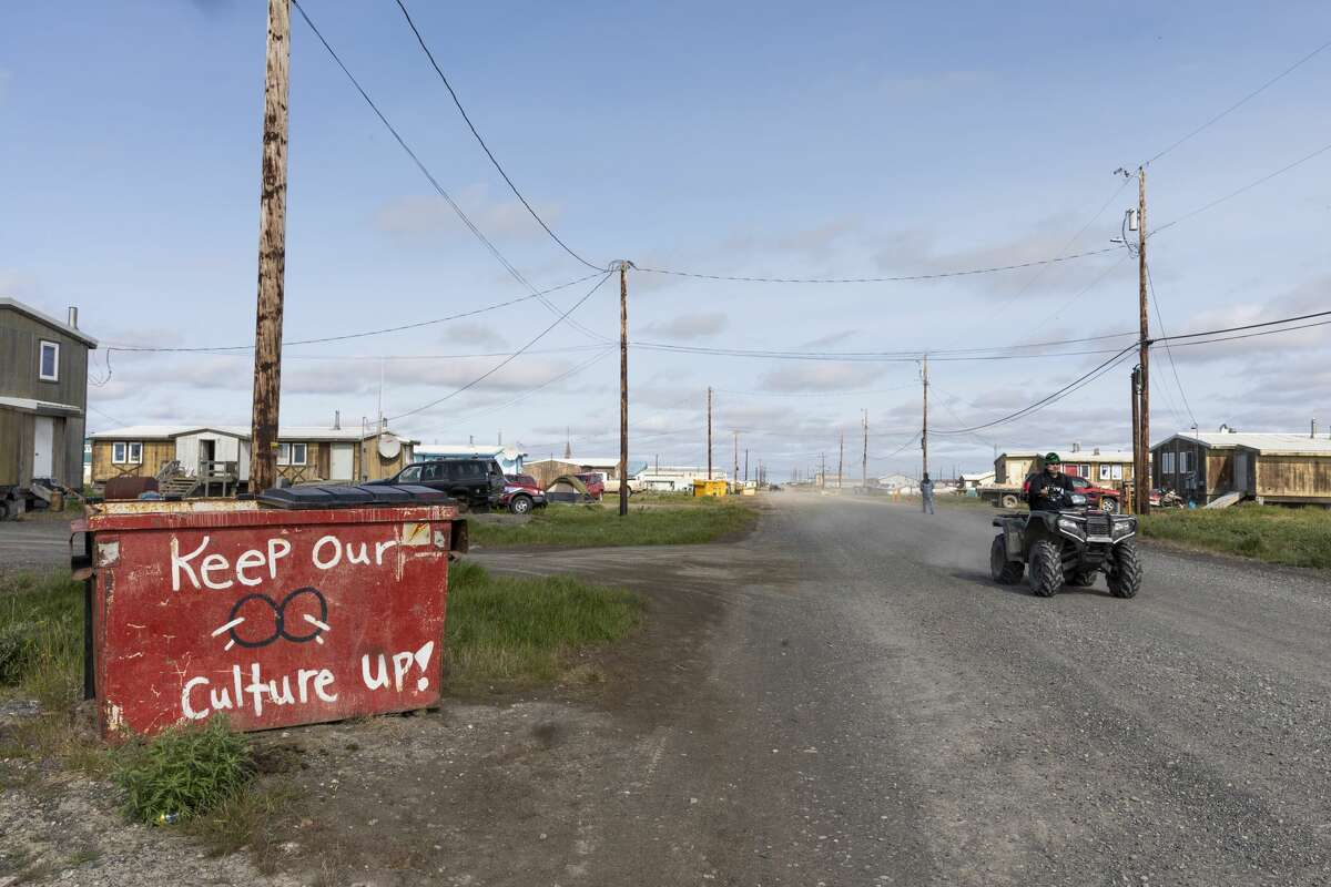 A dumpster painted by the youth of Nuiqsut, Alaska. Each dumpster around the village has a different message and painting.
