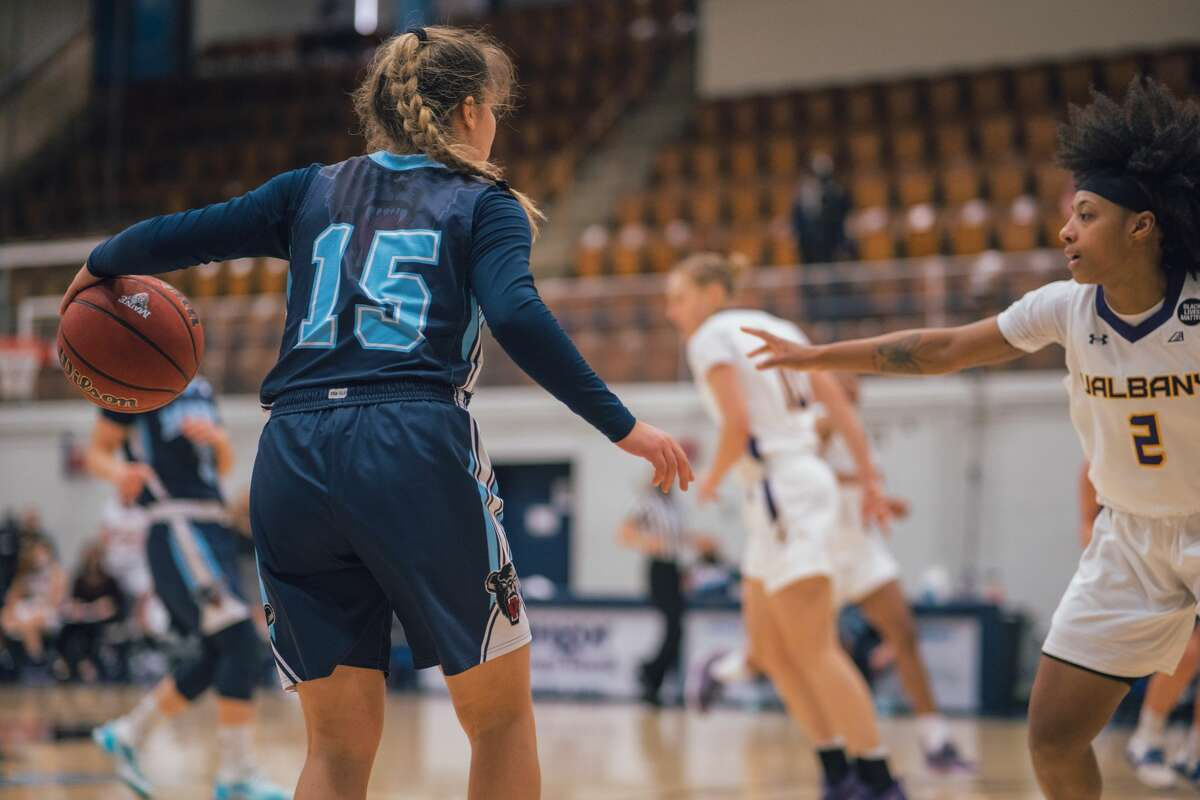 Maine point guard Dor Saar runs the offense as UAlbany senior Kyara Frames defends Sunday, March 7, 2021, in an America East Conference women's basketball tournament semifinal game in Orono, Maine. (Maine athletics)