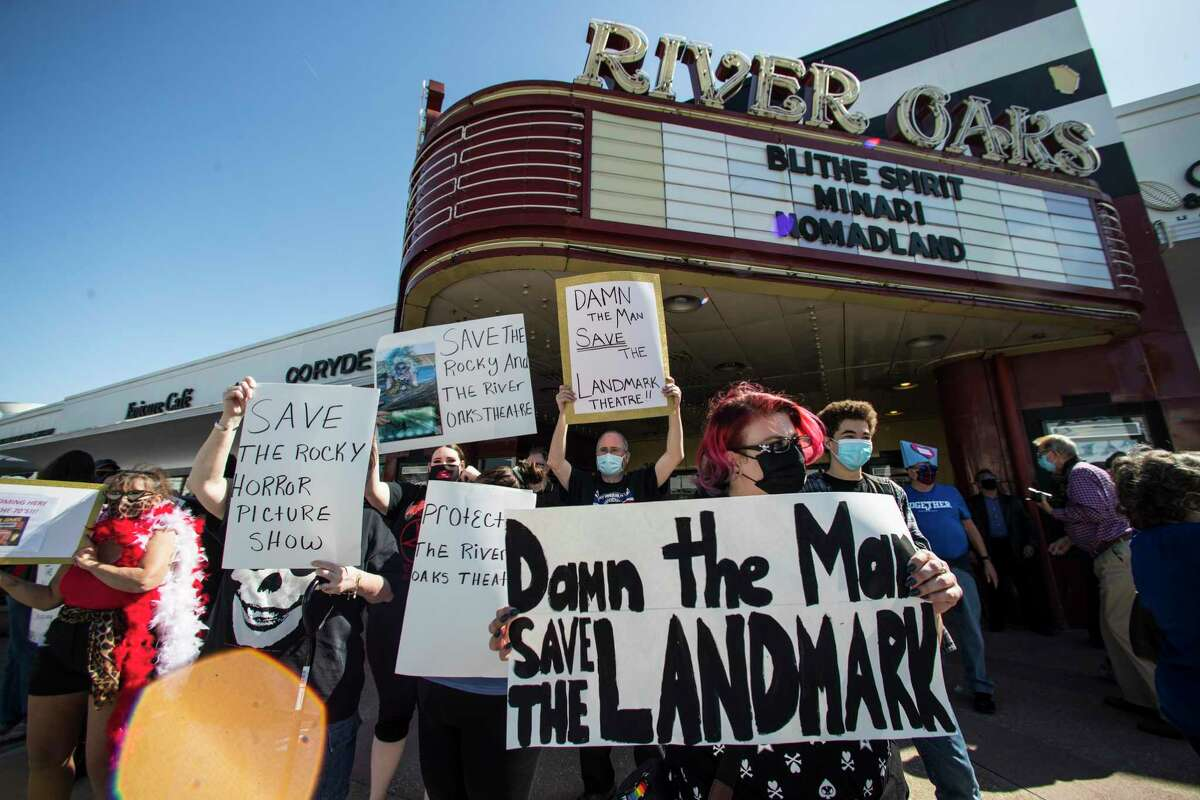 Fans and patrons of the Landmark River Oaks Theatre demonstrate against the potential closure of the historic movie theater Sunday, March 7, 2021 in Houston. The iconic Houston landmark faces a real threat with its lease ending at the end of March, and Weingarten and Landmark Theatres have failed to come to an agreement about its fate.