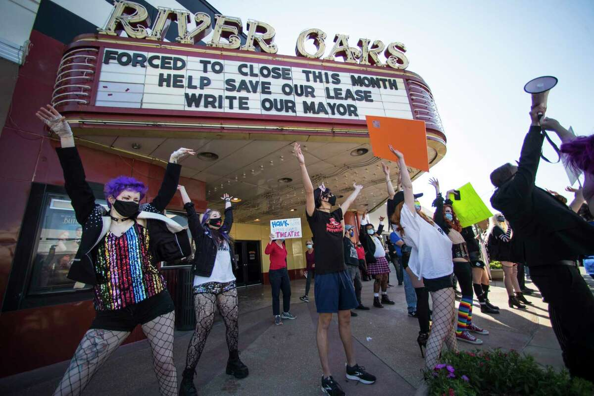 """Fans and patrons of the Landmark River Oaks Theatre do the """"Time Warp"""", from the """"Rocky Horror Picture Show"""" as they demonstrate against the potential closure of the historic movie theater Sunday, March 7, 2021 in Houston. The iconic Houston landmark faces a real threat with its lease ending at the end of March, and Weingarten and Landmark Theatres have failed to come to an agreement about its fate."""