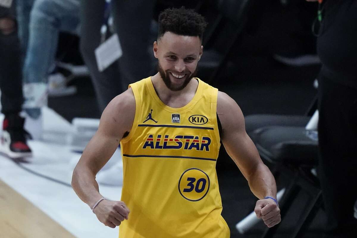 Golden State Warriors guard Stephen Curry celebrates after winning the 3-point contest at basketball's NBA All-Star Game in Atlanta, Sunday, March 7, 2021. (AP Photo/Brynn Anderson)