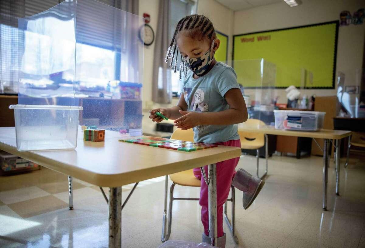 Preschooler Korey Hill works on an alphabet puzzle at Patterson Elementary School in Washington on Friday, Feb. 26, 2021.
