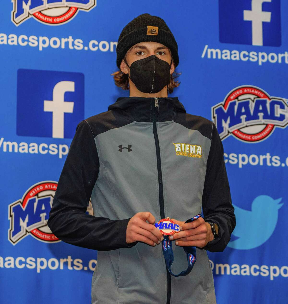 Siena sophomore Brandon Olden poses with his medal after finishing eighth in the 2021 MAAC Men's and Women's Cross Country Championships on Friday, March 5, with a time of 22:48.62.