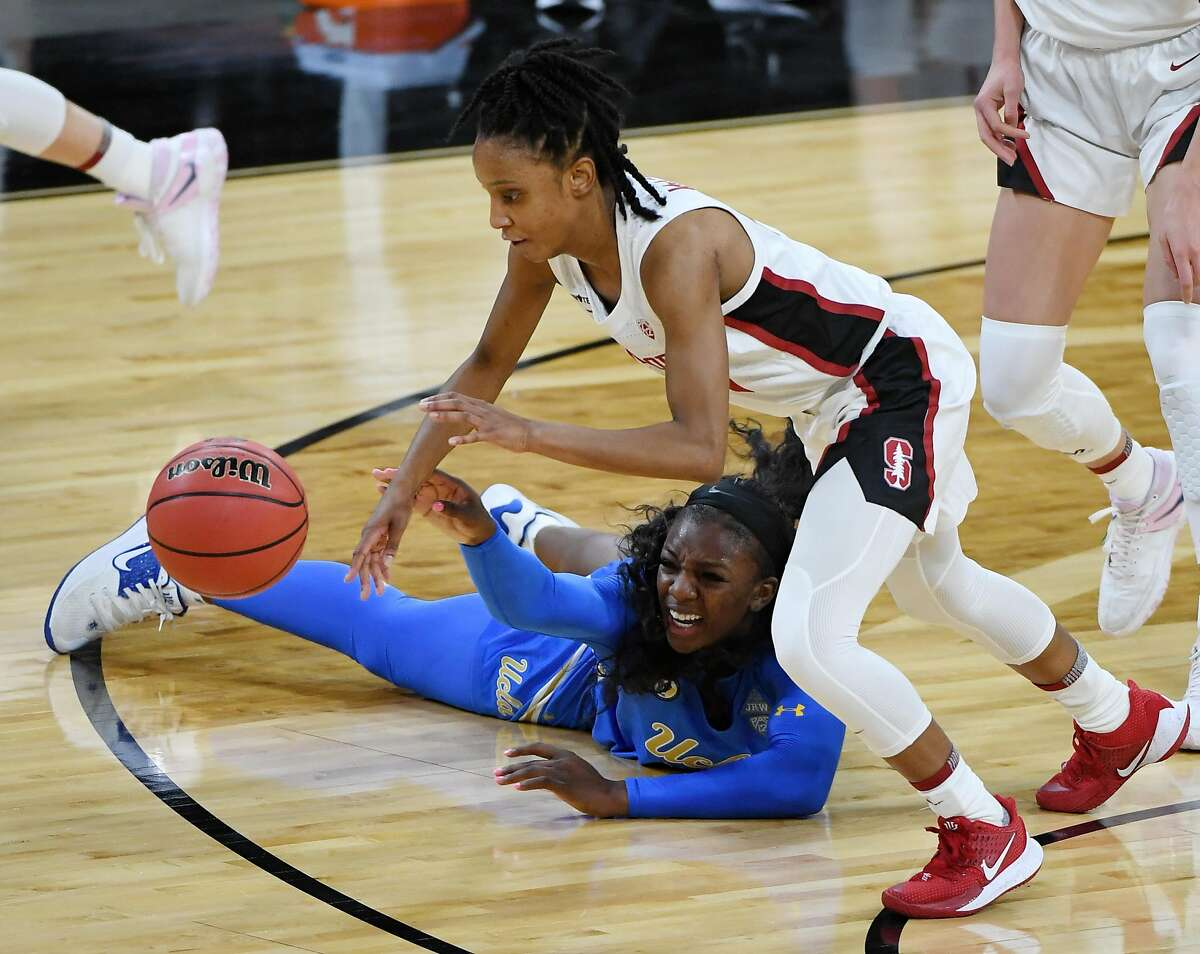 LAS VEGAS, NEVADA - MARCH 07: Kiana Williams #23 of the Stanford Cardinal comes up with a loose ball against Michaela Onyenwere #21 of the UCLA Bruins during the championship game of the Pac-12 Conference women's basketball tournament at Michelob ULTRA Arena on March 7, 2021 in Las Vegas, Nevada. (Photo by Ethan Miller/Getty Images)
