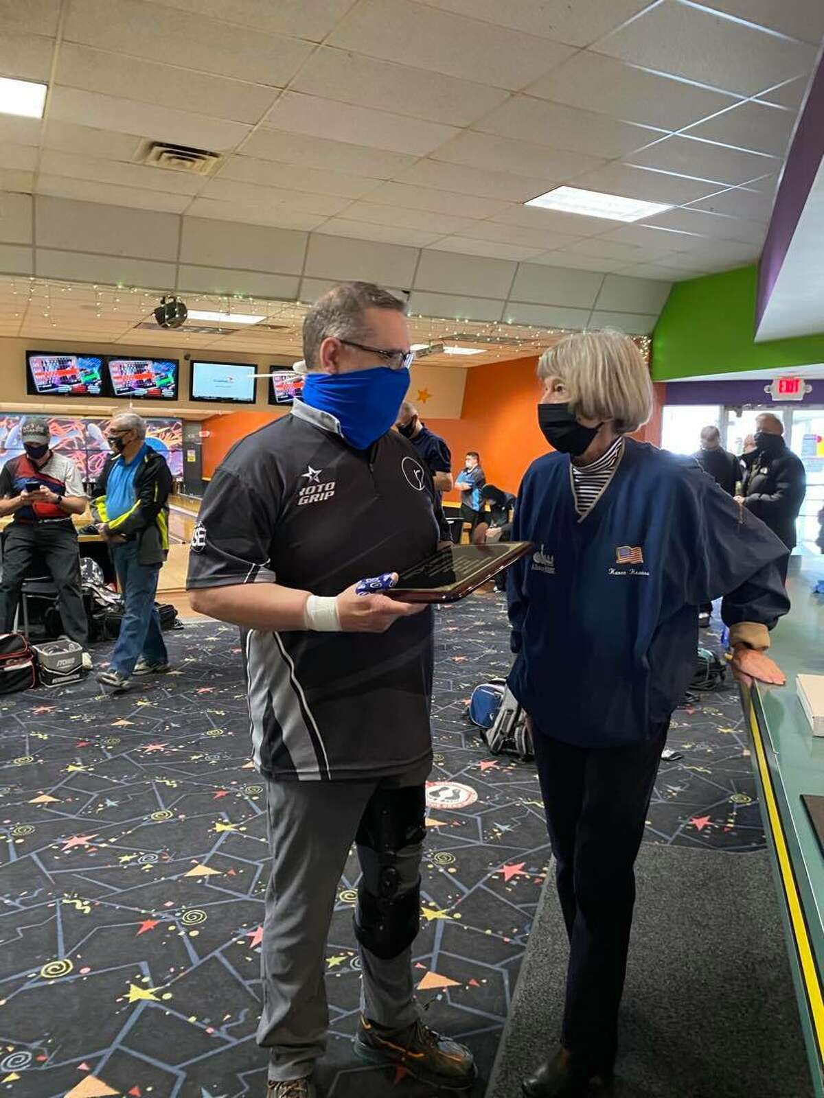 Brian LeClair accepts his Albany USBC Hall of Fame plaque from association manager Karen Krauss. (Photo courtesy Michelle LeClair)