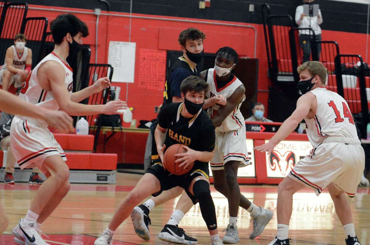 Hand's Ryan Collins is surrounded by Cheshire defenders Jack Markarian, Sincere Myers and Connor DeLaubell on March 7, 2021.