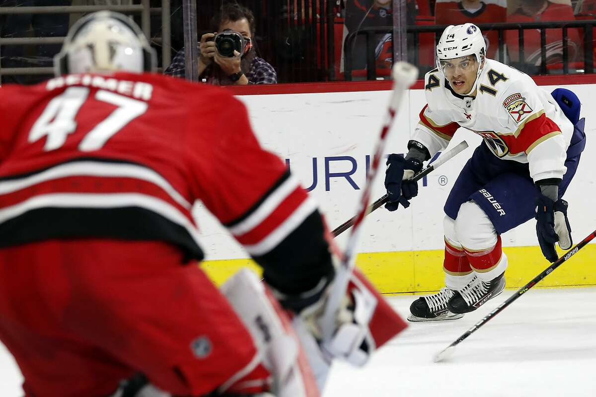 Florida's Grigori Denisenko drives the puck toward Carolina goaltender James Reimer on Sunday in Raleigh, N.C.