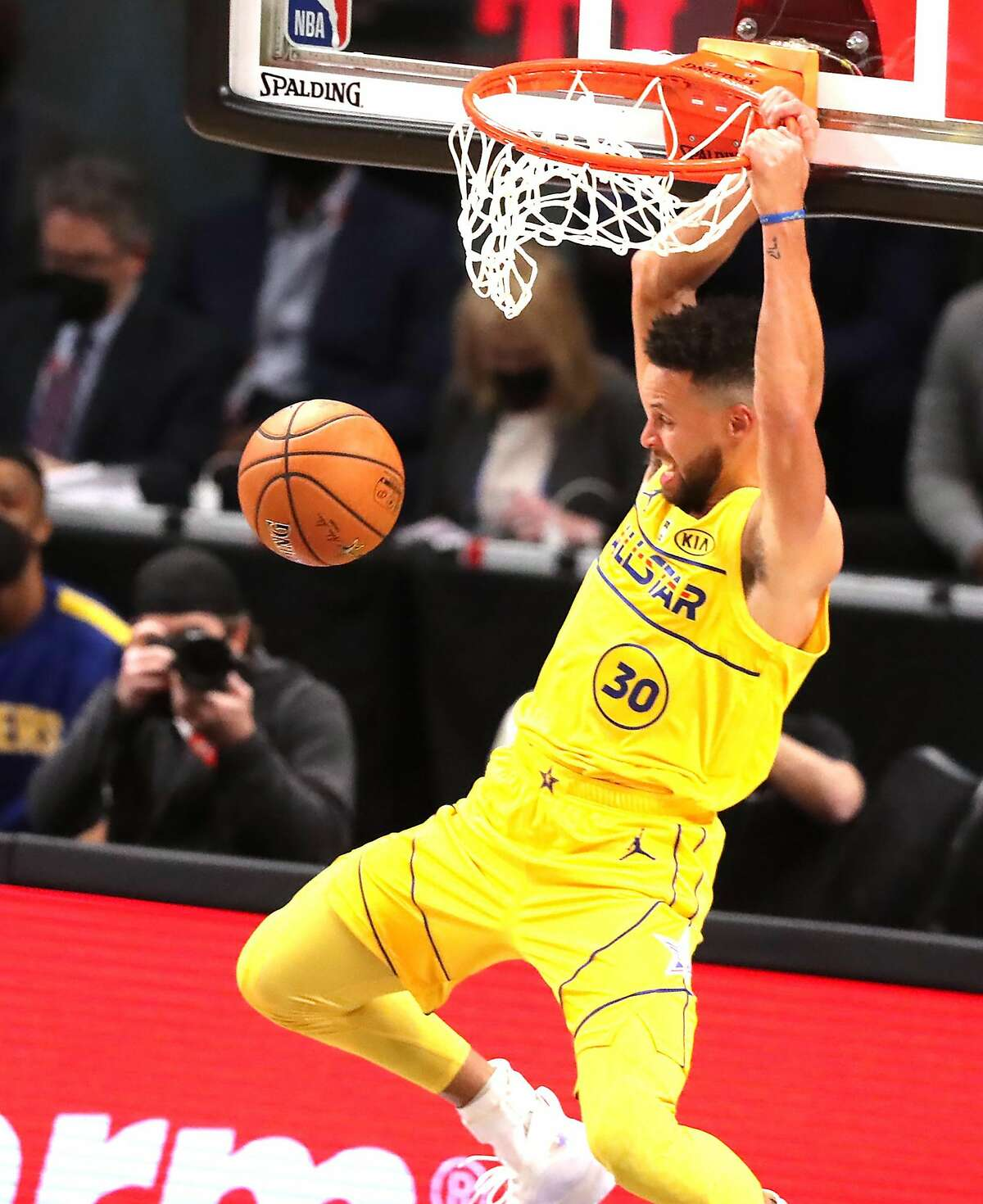 Stephen Curry throws down a rare dunk for two of his 26 points for Team LeBron in an All-Star Game victory.