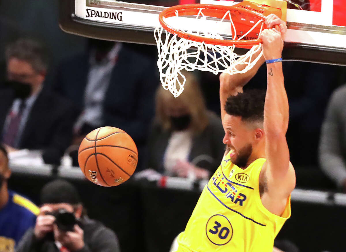Stephen Curry slams during the NBA All-Star Game on Sunday.
