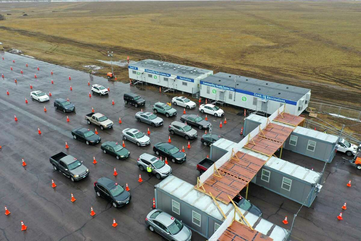 Aerial images show the 10-lane set up for Covid-19 vaccinations on the former Pratt & Whitney Runway at Rentschler Field in East Hartford, Conn. March 1, 2021.