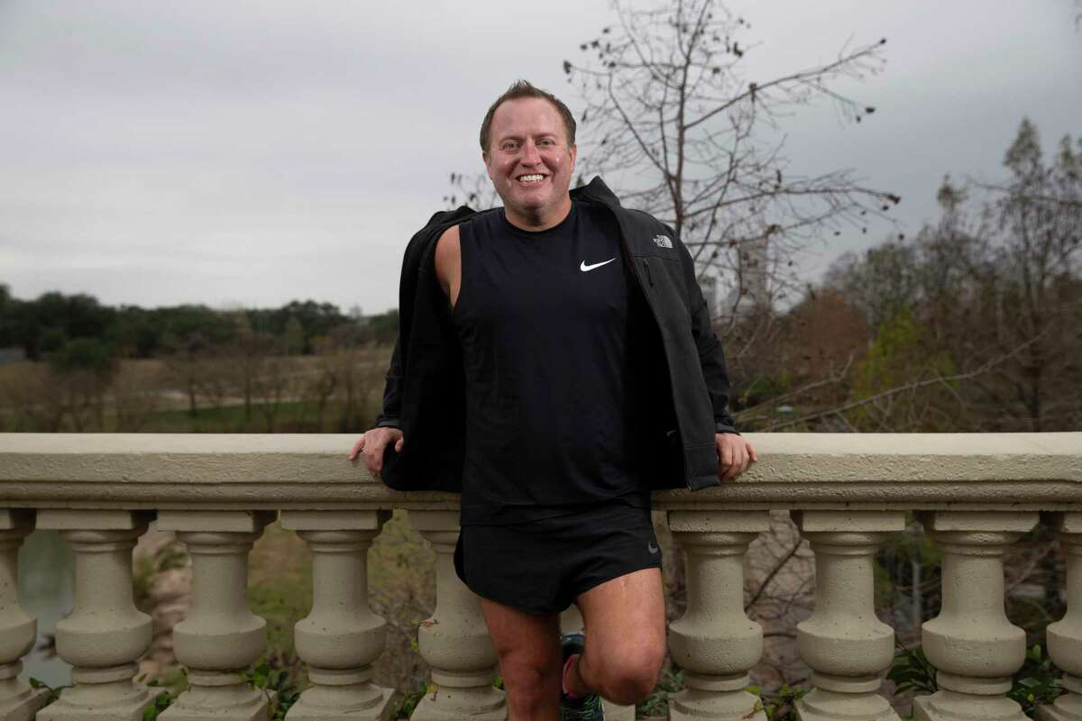 Greg Griffin, 39, poses for a photograph Friday, Feb. 5, 2021, at Buffalo Bayou Park in Houston. Griffin had a slight case of cerebral palsy and he embrased running, joined a running club and even competed in 5Ks and two half marathons, which he raised funds for Buffalo Bayou Partnership.