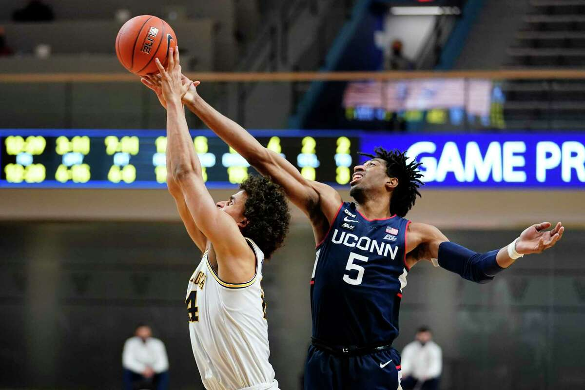 UConn's Isaiah Whaley, right, and Villanova's Jeremiah Robinson-Earl leap for a rebound during a game earlier this season.