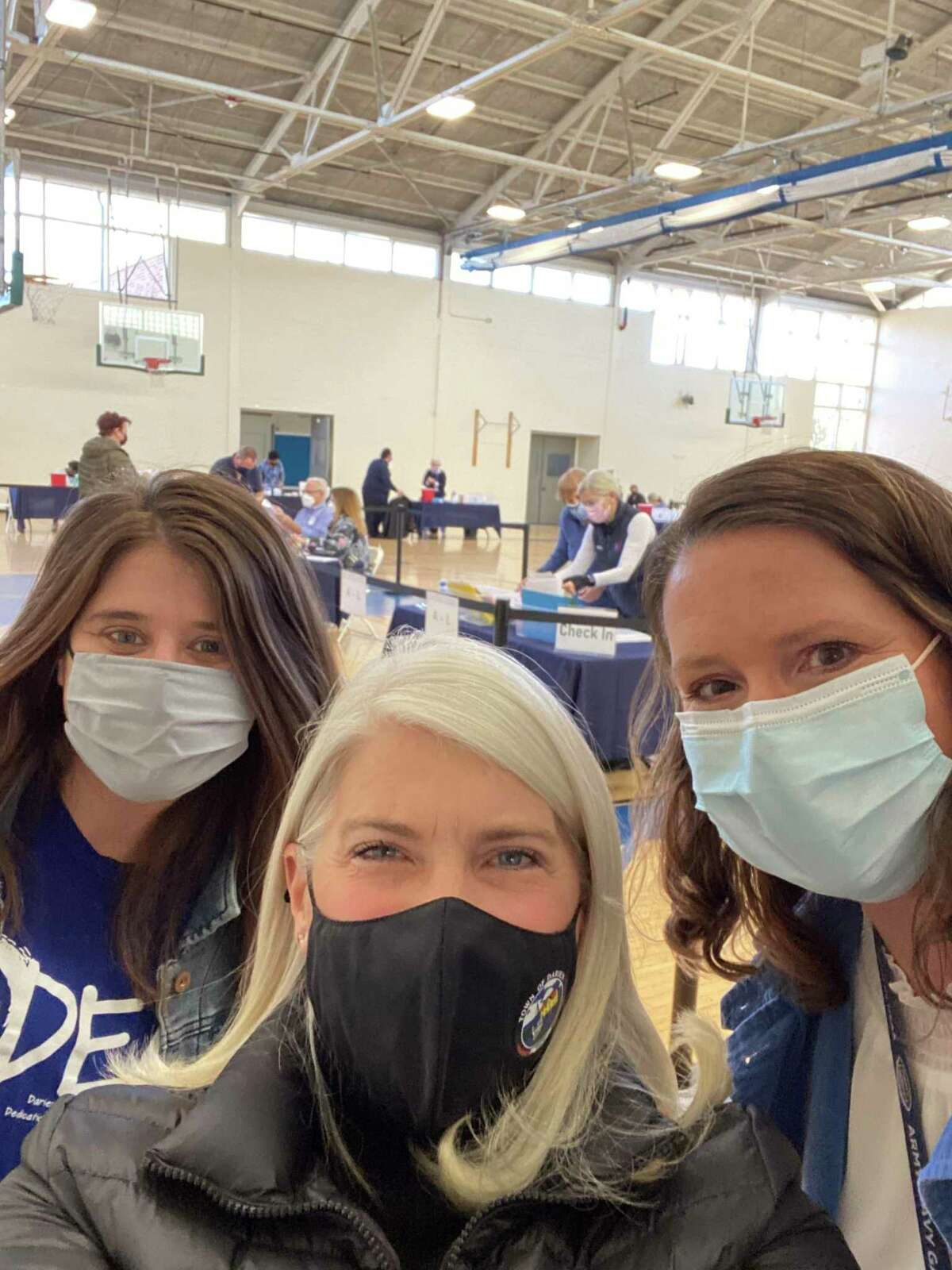 First Selectman Jayme Stevenson, center, at the Darien teachers' vaccination clinic, with Darien teachers union president Joslyn DeLancey, left, and with Alicia Casucci, head of nursing for the schools.
