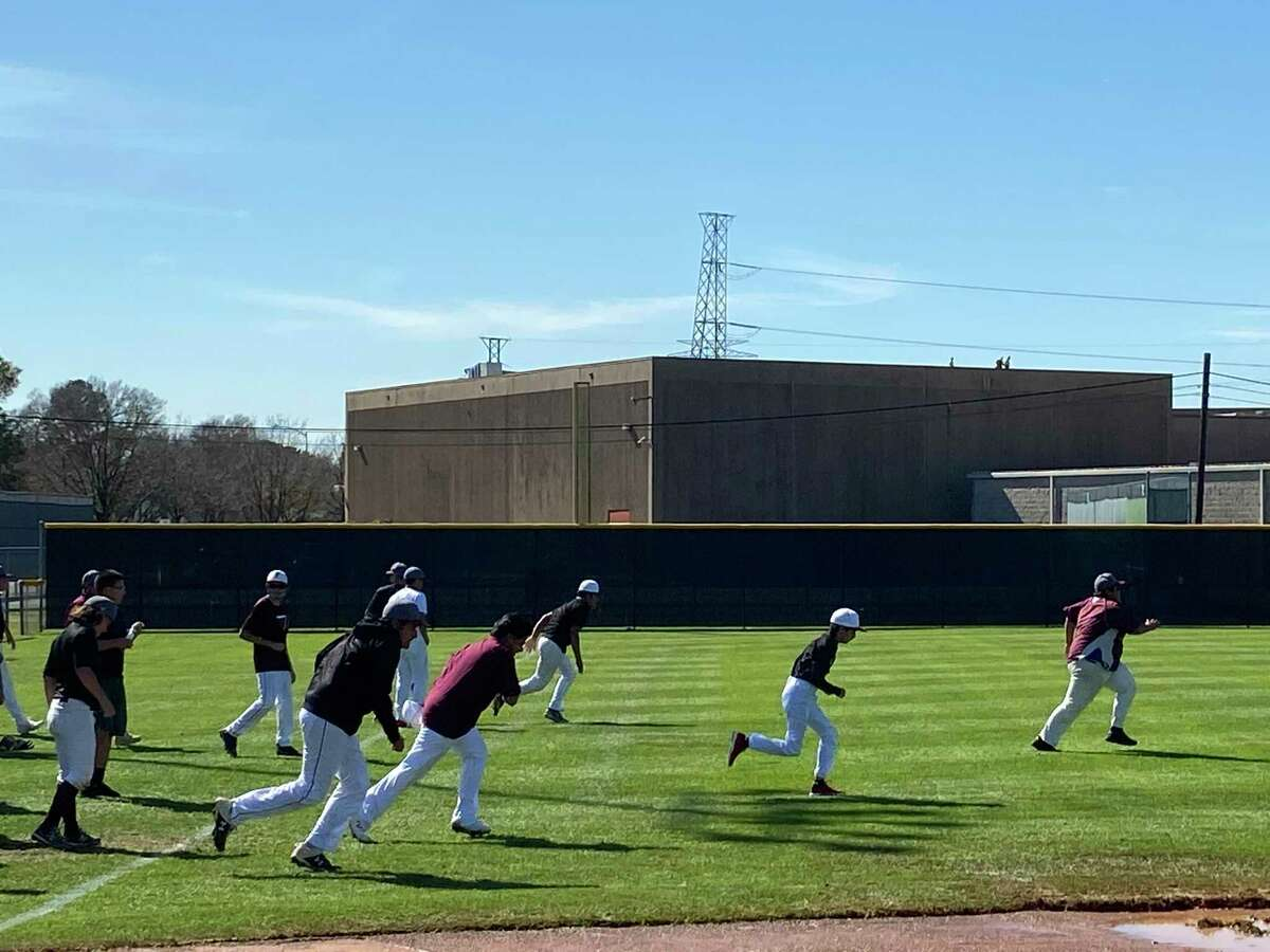 The Northbrook Raider baseball team warms up at the beginning of practice on March 3