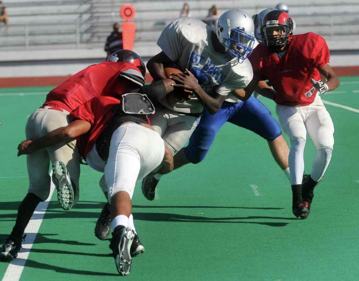 West Haven's Ervin Phillips is tackled during a scrimmage at Bridgeport Central on Wednesday, September 8, 2010.