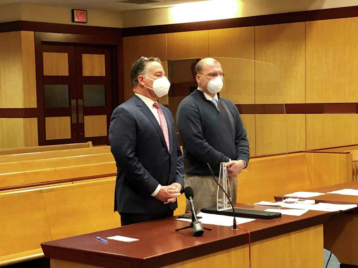 State police Sgt. John McDonald, right, appears with his attorney, Robert J. T. Britt, Monday in Superior Court in Middletown.