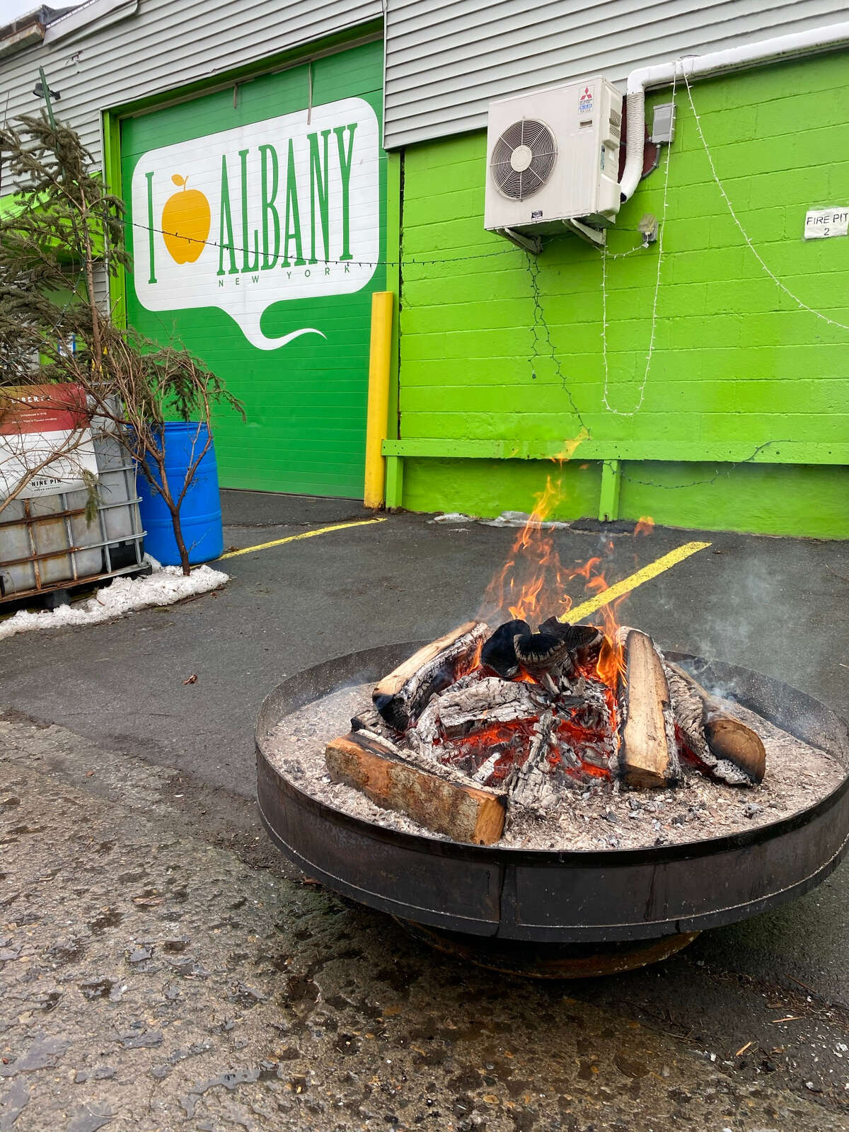 A firepit at the Nine Pin Ciderworks in Albany's warehouse district. (Susie Davidson Powell for the Times Union.)