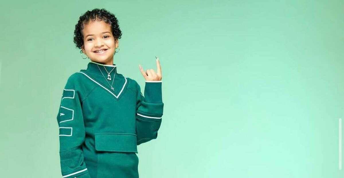Lyric Chanel posing in Beyoncé's Ivy Park athleisure line.