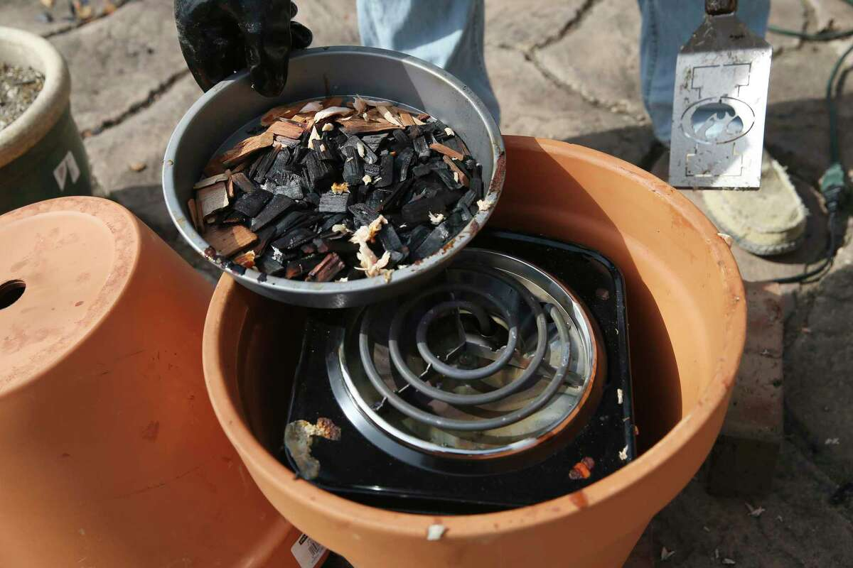 The DIY flower pot smoker requires an electric hot plate, wood chips, a grill grate and two terra cotta pots.