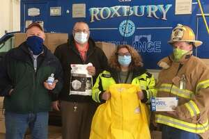 Ocean State Job Lot Charitable Foundation Executive Director David Sarlitt, Ocean State Job Lot store team leader Rich Stomski, Roxbury Ambulance Association Chief Sarah Lauriat and Roxbury Volunteer Fire Chief Todd Wheeler.