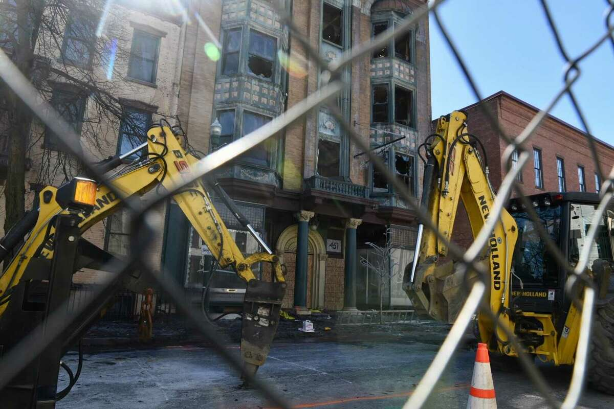Heavy equipment is seen at the sight of a fire that badly damaged 451 Broadway on Saturday. Troy officials said they are speaking with the owner of the building about whether the structure can be saved.