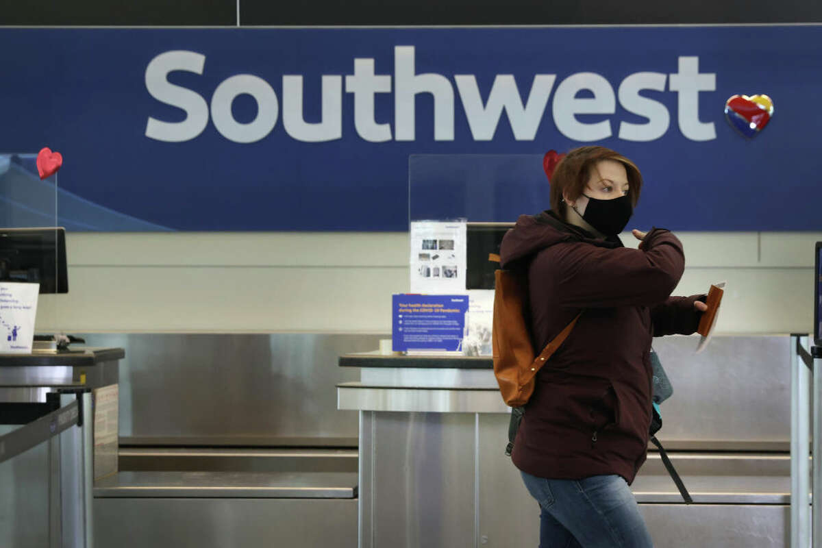 CHICAGO, ILLINOIS - JANUARY 28: Passengers check in for Southwest Airlines flights at Midway International Airport on January 28, 2021 in Chicago, Illinois. Southwest Airlines today reported its first annual loss since 1972. The pandemic has wreaked havoc on the industry in 2020 with U.S. airlines reporting a combined $34 billion loss. (Photo by Scott Olson/Getty Images)