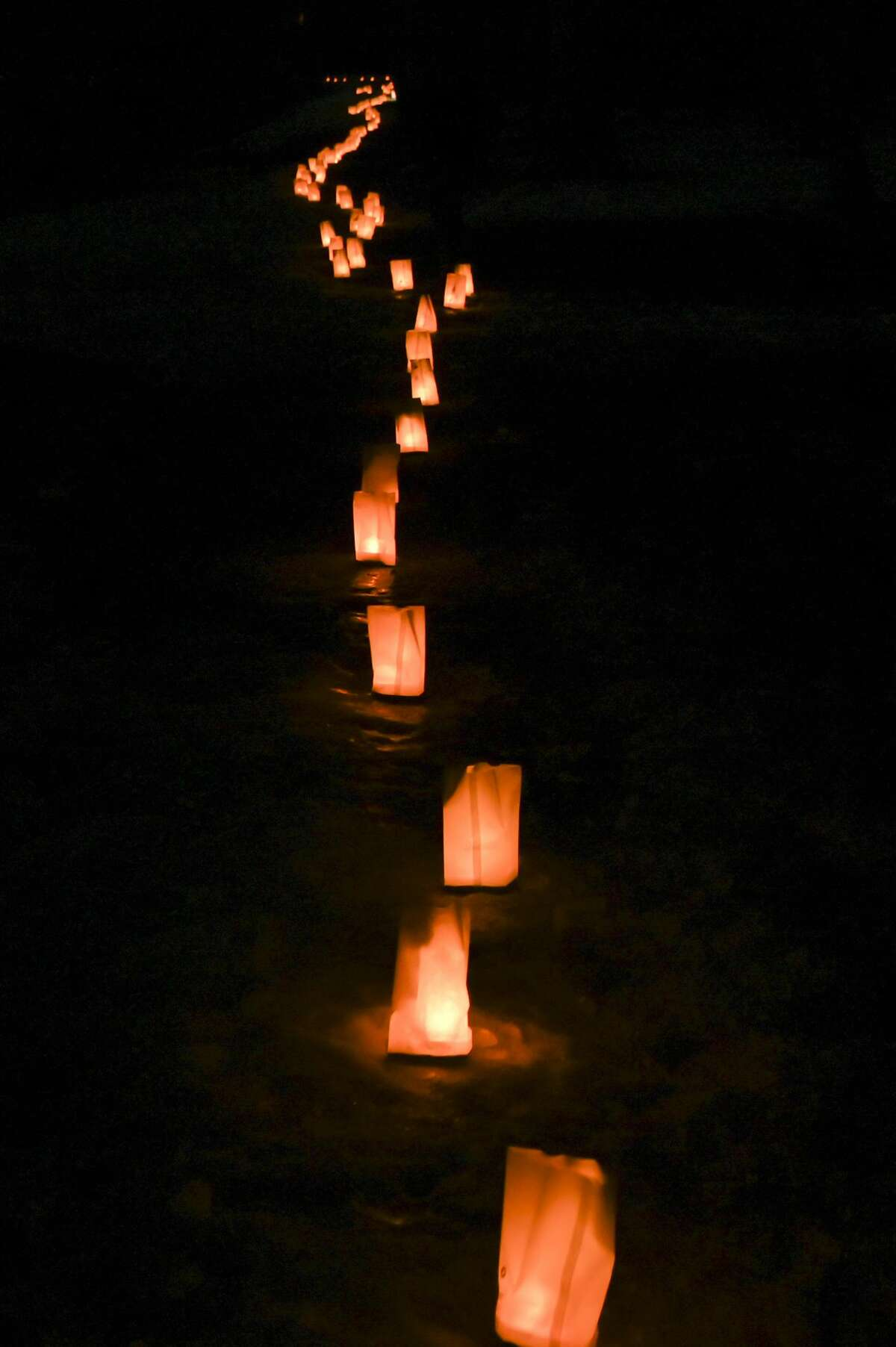 Students from Midland High School hold a luminary walk as the culmination of their