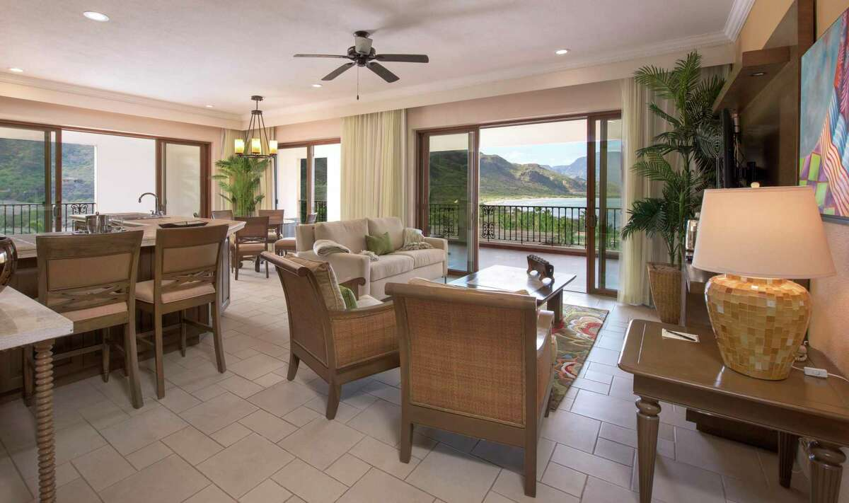 The units boast open floor plans with recessed lighting and sliding glass doors opening to view decks.