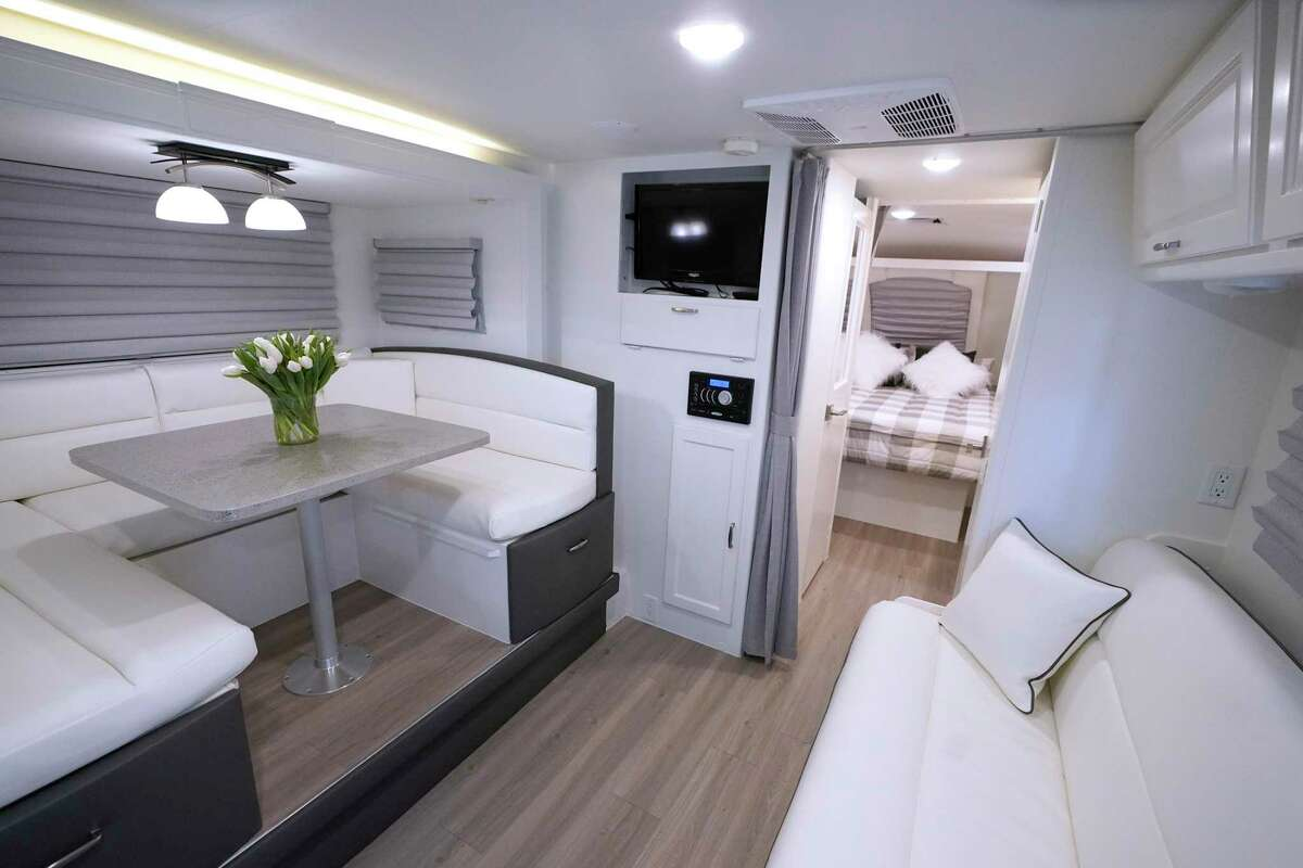 Tony and Bridget Caletka of The Woodlands hired designer and contractor Andee Parker to redo the interior of their Lance RV. The improvements included repainting the walls and cabinets, resurfacing the tabletop with epoxy paint and adding new flooring and window treatments.