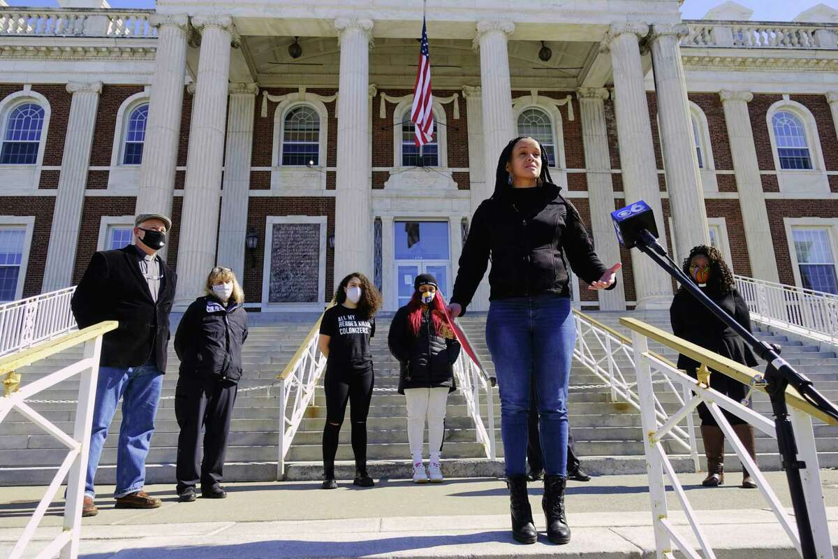 Jamaica Miles, with the group All Of Us, speaks about the Reform and Reinvention Collaboration Report and about the process to get to the final report during a press conference on the step of city hall on Monday, March 8, 2021, in Schenectady, N.Y. (Paul Buckowski/Times Union)