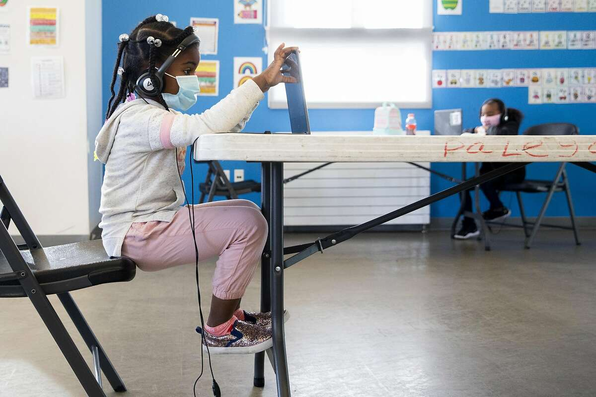 Kindergartener Nia Jackson attends her Zoom class virtually at the Palega Community Learning Hub at Palega Recreation Center in San Francisco. Kindergarteners are expected to head back to schools starting in April.