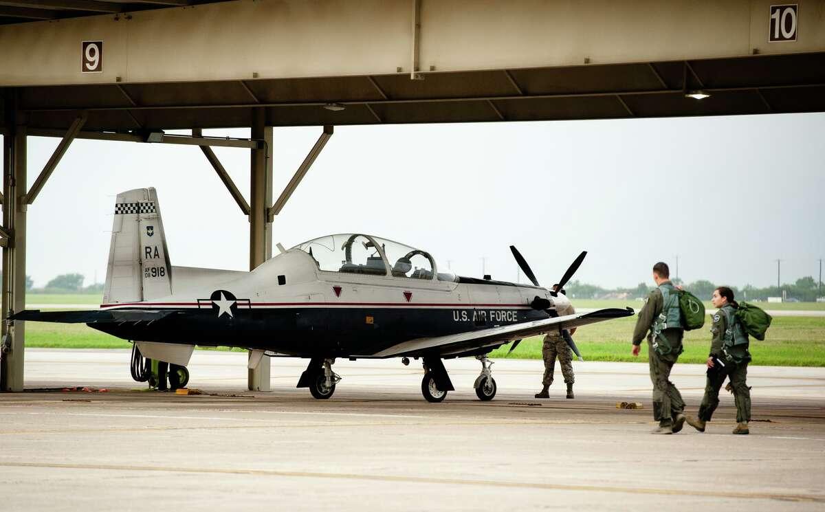 "Air Force pilot 2nd Lt. Alyssa Garmon and Capt. Paul ""Easy"" Makuszewski prepare for a training flight as part of the Air Force's Pilot Training Next program."