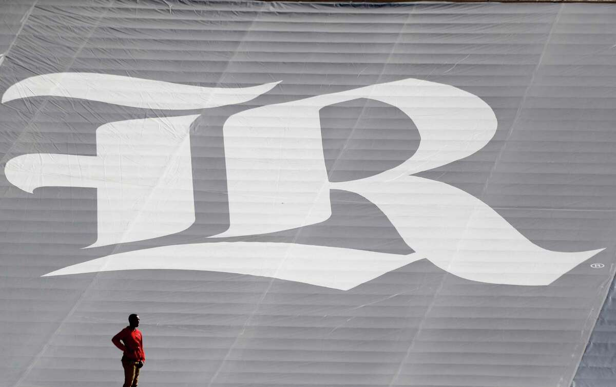 A man stands near the Rice Owls logo in the first half of a college football game at Rice Stadium, Saturday, Nov. 25, 2017, in Houston. ( Karen Warren / Houston Chronicle )