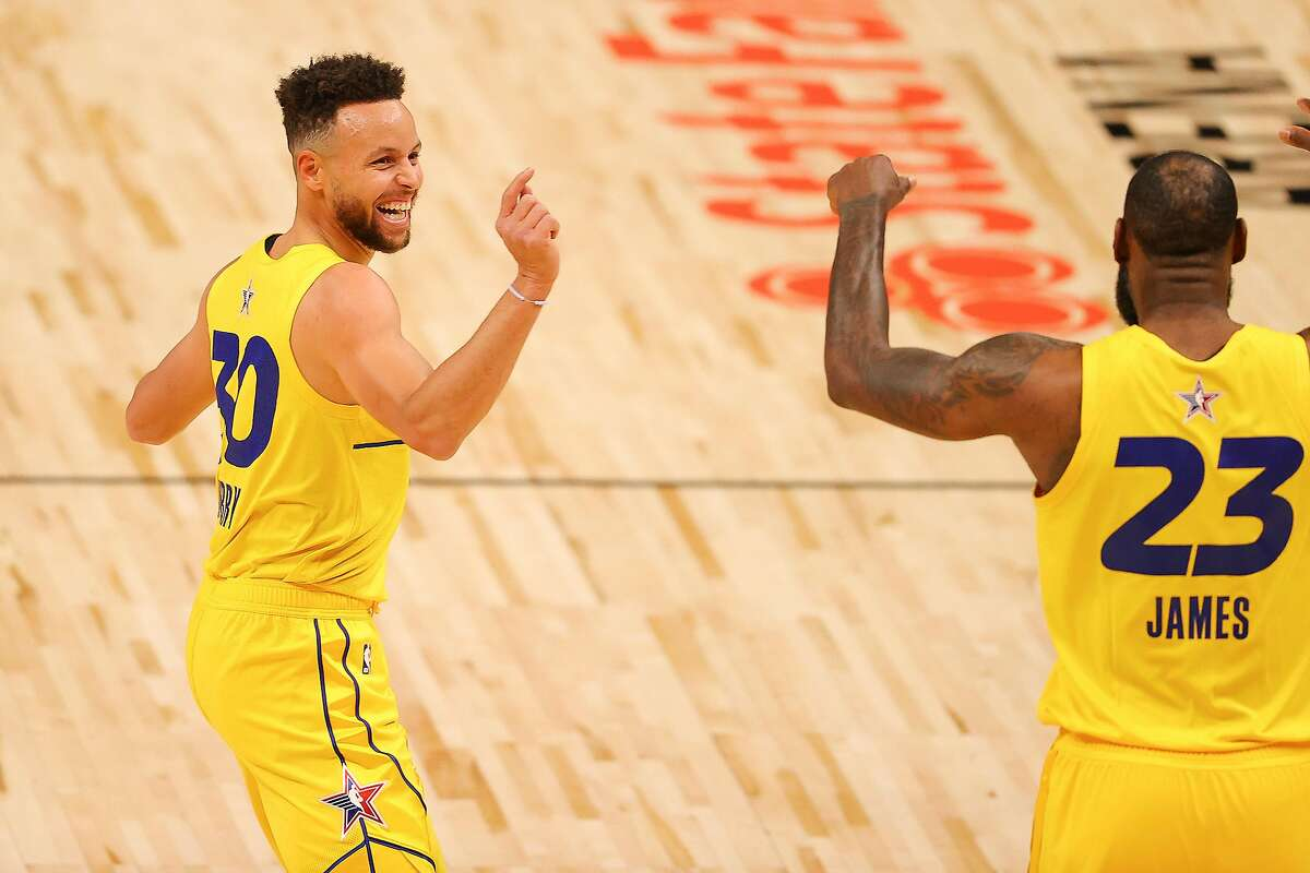 ATLANTA, GEORGIA - MARCH 07: Stephen Curry #30 and Lebron James #23 of Team James react during the first half against Team Durant in the 70th NBA All-Star Game at State Farm Arena on March 07, 2021 in Atlanta, Georgia. (Photo by Kevin C. Cox/Getty Images)